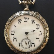 Some vintage pocket watches, including a Hebrew watch like one found on the Titanic
